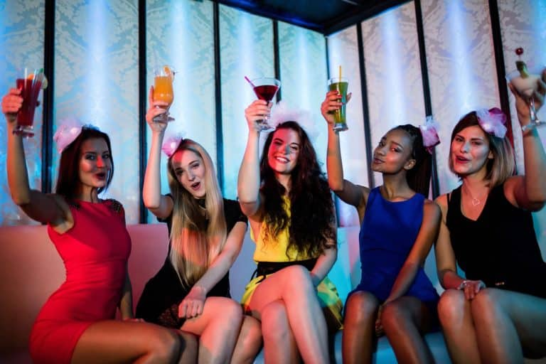 Group of young girls having fun drinking mocktails